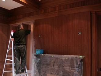 on-site finishing of walnut library interior